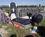 08.  Family cleaning grave in block 50